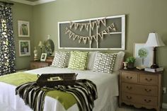Looking for a use for our old screen door we removed...this headboard idea is cute!