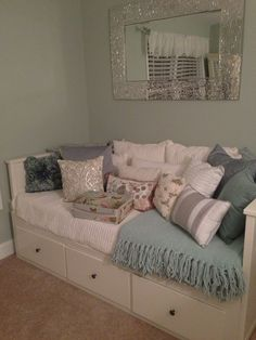 Ikea Daybed.....less pillows change knobs on drawers Love the sideways mirror over the daybed. - J