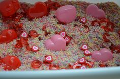 Just some rainbow rice, plastic heart boxes, plastic X and O pieces and little heart erasers.   Simple, cute and girly!