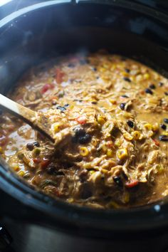 This Queso Crockpot Chicken Chili recipe with roasted corn, jalapeño, and creamy Pepper Jack cheese is full of flavor. 300 calories.