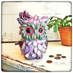 Lovely 'LuLu', mosaic owl, coin bank, is an adorable way to save your pennies for a rainy day ....or maybe for a mocha latte ☕️❣️ 'LuLu's' design started with a bisque base form bank...the coin slot is located in the back of her head and there is a hole at the bottom ...that has a