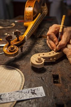 Hands crafting a Stradivarius... Grand!