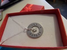A simple 19mm round washer stamped with names and finished with a simple heart charm