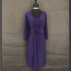 "This is a beautiful Jones New York Brand plus size dress. The dress has a rounded beck line, is a one Piece with no zippers, and has a fashionable decorative bow in front. The dress is deep purple made of polyester. It is a US size 16 with the following measurements:    Length: 41.5""  Bust: 42"" - 56"" (stretchy material)  Waist: 38"" - 48"" (stretchy material)     This item ships immediately to US addresses. 📦 Also available for local try on and pick up in Sacramento, CA. ✨    This item is…"