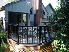 A large deck and hot tub privacy fence.