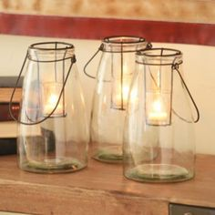 Clear Glass Lantern   Kirklands.  As shown in the cabin of So Much Better With Age blog.  http://www.somuchbetterwithage.com/2014/11/rustic-finds-from-kirklands/?utm_source=My+Active+Subscribers&utm_campaign=302cb9150b-RSS_EMAIL_CAMPAIGN&utm_medium=email&utm_term=0_786a35cf68-302cb9150b-83419229