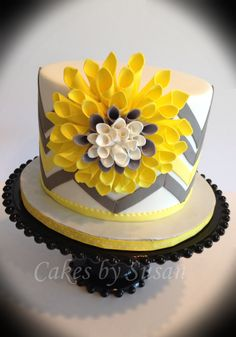 Birthday Cakes - Yellow and gray chevron cake. I saw this flower made out of paper so thought I would give it a try out of gumpaste.