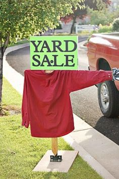 Cute idea for a yard sale sign!  I'm going to use an old flannel shirt.