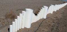 """How to Make a Fence from Recycled Plastic PVC Pipe class= """"I love being a plumbers wife.we always have these pipes just laying around. Time to put them to use!"""