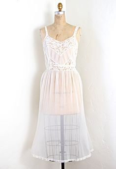 $58.00  Vintage 1950s lingerie slip dress with accordion pleats on the skirt and pleats on the bodice with lace in a chevron stripe design. Has a hole along the hips (see photo) which falls into the pleats so not too noticeable when worn.