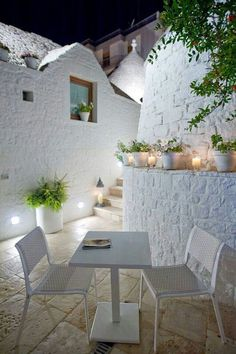 White stone, candles, plants