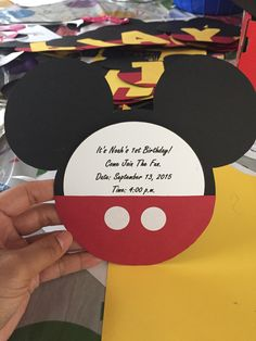 DIY Mickey Mouse invitations . Used card stock for both the Mickey head and the invite description. Used all purpose labels for the dots and red construction paper