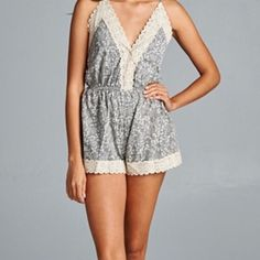 SALE!! Grey Lace Trim Romper Adorable grey lace print romper! Backless, fully lined and brand new with tags. 15% discount on bundles. No PayPal or trades. HOST PICK Vacation Essentials Party 7/25 2 Large left! Please make any offers using the offer button! Thanks! boutique Pants Jumpsuits & Rompers