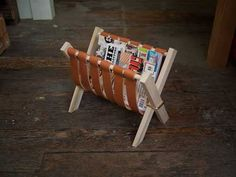 handmade storage bin for magazines made with leather belts