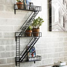 A miniature fire escape to display succulents, pictures, and other assorted knickknacks on. | 33 Products That Are Almost Too Clever To Use
