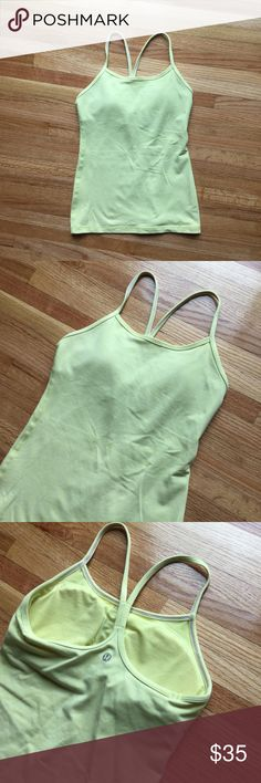 Lululemon power y tank Size 4. Built in bra with padding included. Great condition! Last photo is a stock photo to show the fit. lululemon athletica Tops