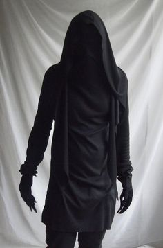 Details:  -the hood has sharp end and attached only around the back of the neckline -a long mask like neck going as high as the forehead ( layers of mesh / fishnet) -all fabric edges hemmed except on the hood, this type of fabric wont curl  The material is rayon which is heavier than an average t