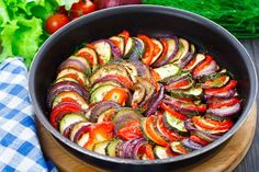Ratatouille Casserole Recipe Main Dishes with tomato paste, onion, minced garlic, olive oil, water, eggplant, zucchini, yellow squash, bell pepper, fresh thyme leaves, salt, pepper