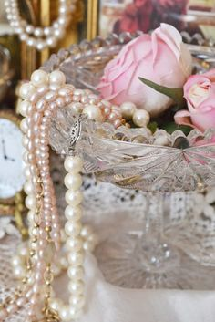 pearls and roses. This reminds me of stuff I see at Grandma's house