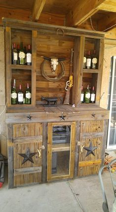 Now come towards this wood pallet bar closet. This could best be used outdoor because of the rustic wood that is used in here. This large wooden closet has multiple cabins and drawers where you can place a number of accessories that you need while sitting outside.