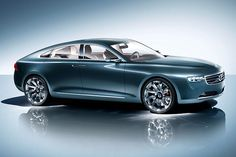 Volvo Concept. I like it! I could tote my future munchkins and their soccer balls in this right?