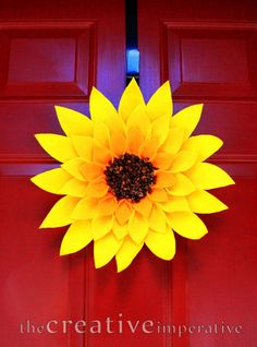 Sunflower wreath made from yellow felt a paper plate and coffee beans! So fun for summer!