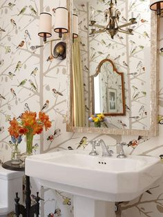 Sarah's House:  Suburban house's bold powder room with bird-patterned wallpaper.