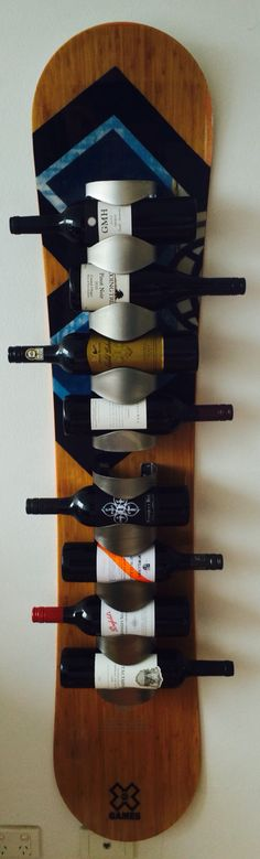 Snowboard wine rack, DIY. Snowboard furniture is great use of old boards. This is my favourite snowboard piece.