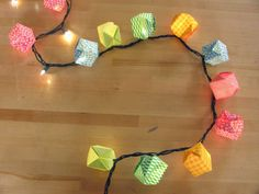 Must do for next party! Easy way to use up all those origami papers I'll never need.
