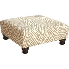 Create a chic focal point in your living room or den with this stylish camel-hued cocktail ottoman, featuring animal-print upholstery and turned legs.