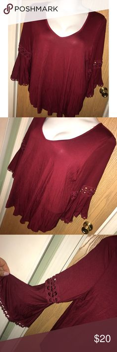 "Dark red lace inset bell sleeve top Super pretty dark red lace/crochet inset and trim bell sleeve top. Never worn. 27"" from armpit to armpit, 28"" total length. Roommates Tops"