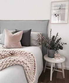 I have pinned this as there are soft pink tones greys and black and also a big chunky throw that adds texture to the bed, which are all things my client has ask for .