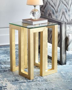 "Handcrafted side table. Glass top. Iron base. Gold-leaf finish. 17""Sq. x 24.75""T. Imported. Boxed weight, approximately 38 lbs."