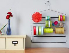 Love this idea for storing ribbon for wrapping or craft projects. Tried using a tension rod, but don't have two walls to hang it on. This is a much better idea.