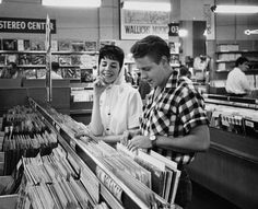 1959, Los Angeles, CA ~ Rockabilly singer Eddie Cochran and his fiancee, songwriter Sharon Sheeley, shop for records in a Los Angeles music store. ~ Image by © Douglas Kirkland