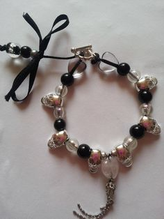 Beaded skull bracelet. By black ribbon.