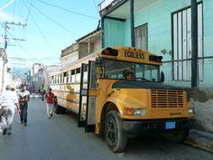 Beautiful old schoolbus in de streets of Santiago de Cuba, Cuba