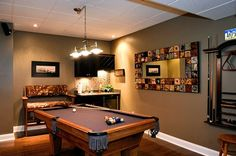 Finished basement with a media area, pool table area, wet bar, and gas stove.