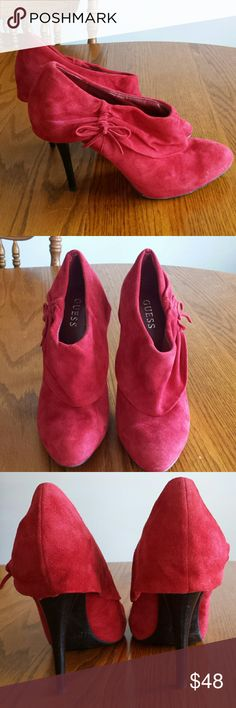 """Guess red booties Suede booties featuring a sweet little bow by the ankle and a 4 1/2"""" heel. May need some cleaning here or there but these are still in great condition. The soles are also in great condition.  These are also one of my favorites that I hate letting go but they have been sitting in my closet when they should be trophied. Guess Shoes"""
