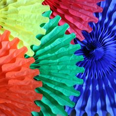 paper tissue giant coloured fan decorations by pearl and earl   notonthehighstreet.com