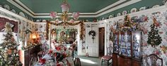 The most wonderful time of the year: The dining room of the Crances' historic home overflows with Christmas trees, wreaths, swags, candles and angels.