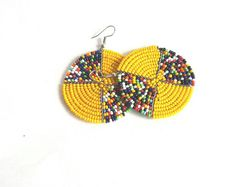 These colourful African Earrings are made using fine beads. The earrings are very light and can be worn in any occasion. **Buy multiple items and pay shipping for 1 item only.The rest ships free. Beaded Tassel Earrings, Bead Earrings, Earrings Handmade, Women's Earrings, Beaded Jewelry, Handmade Jewelry, Craft Jewelry, Ring Necklace, Gold Jewellery