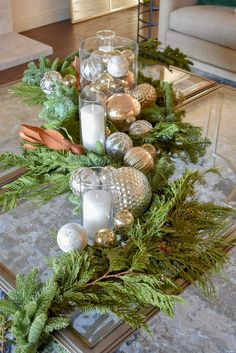 An Elegant Silver and Gold Christmas Centerpiece with Evergreens on glass coffee table Flocked Christmas Trees, Real Christmas Tree, What Is Christmas, Christmas Mantels, Gold Christmas, Christmas Balls, Simple Christmas, Christmas Home, Christmas Ideas
