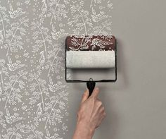 Instead of using pricey wallpaper, use a fun combination of paint colors with these fun and functional patterned rollers.