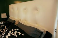 DIY tufted upholstered headboard made from a door