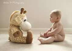 Baby and soft toy. Adorable!