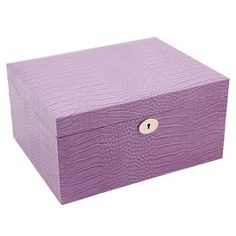 """Leather jewelry box with removable valet tray and drawer.  Product: Jewelry boxConstruction Material: Wood and leatherColor: PinkFeatures:  Removable valet and mirrorKey lock Dimensions: 6"""" H x 11.75"""" W x 9"""" D"""