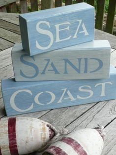 Decorative wood block idea. Stencil the words Sea, Sand and Coast on wood blocks.