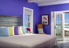 LOVE the wall color and that headboard! I would want to add  lighting ( wall arm lamps?) and real pillows and a few other touches.