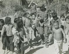 Vietnam Army WAC with Vietnamese children.